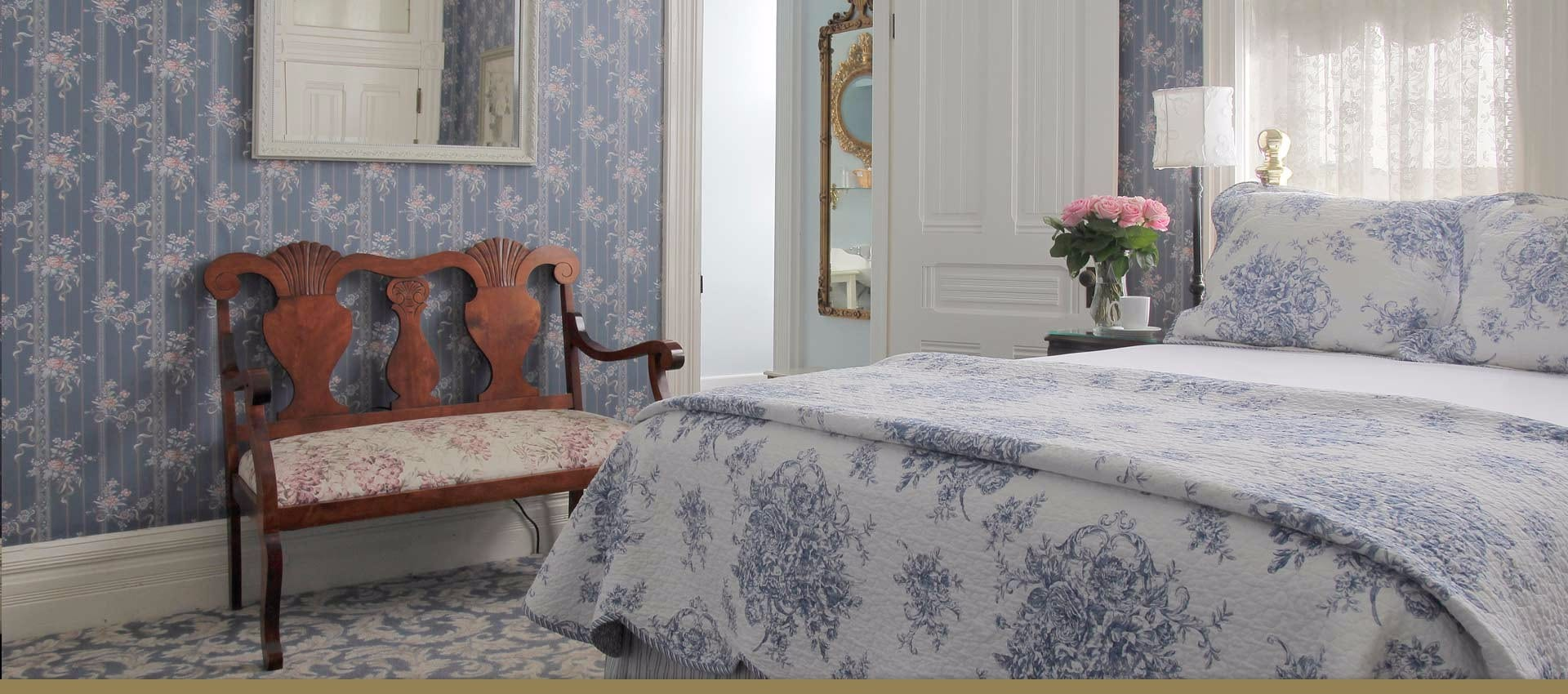 Victorian Inn Boutique Hote bed and sitting chair