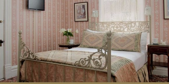 Emily Rose Room queen bed and side tables