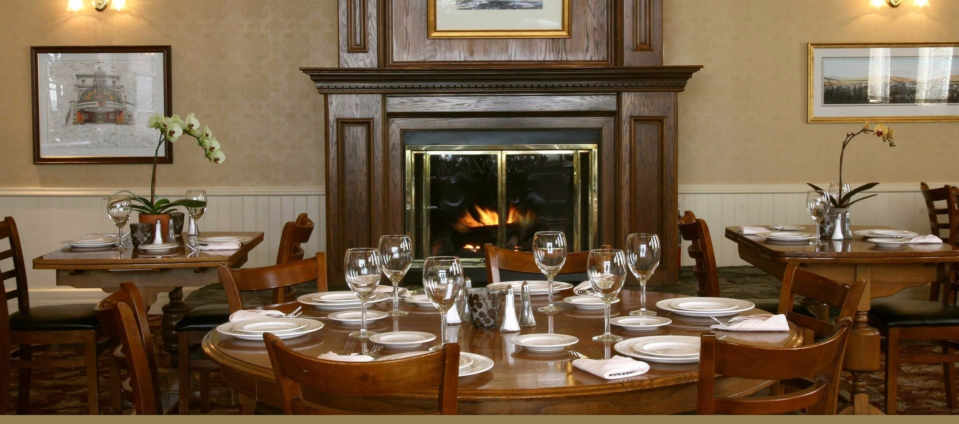 Victorian Village Inn Dining room with fireplace