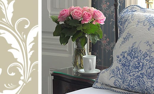 Eel Valley Suite room detail with vase of roses and cup of tea