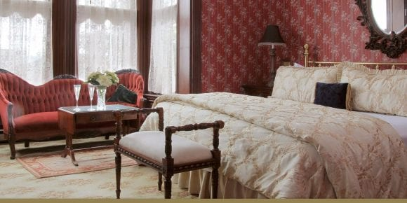 Victorian Parlor sitting area and bed in victorian decor